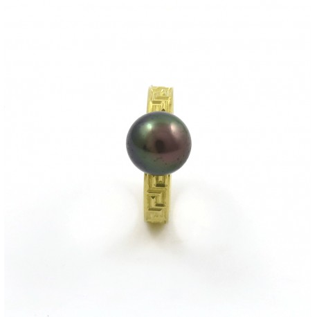 A tatooed ring with a bicolor pearl