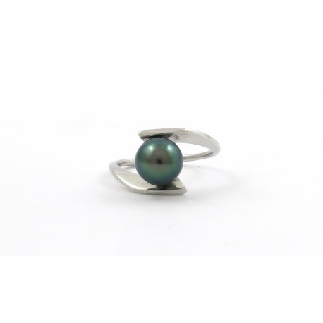 A modern ring with a small green pearl